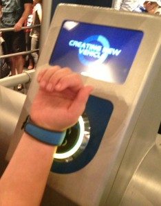 Using MagicBands just before entering the ride vehicle at Test Track to bring up the car design customized earlier.
